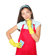 Woman in red apron wearing cleaning gloves