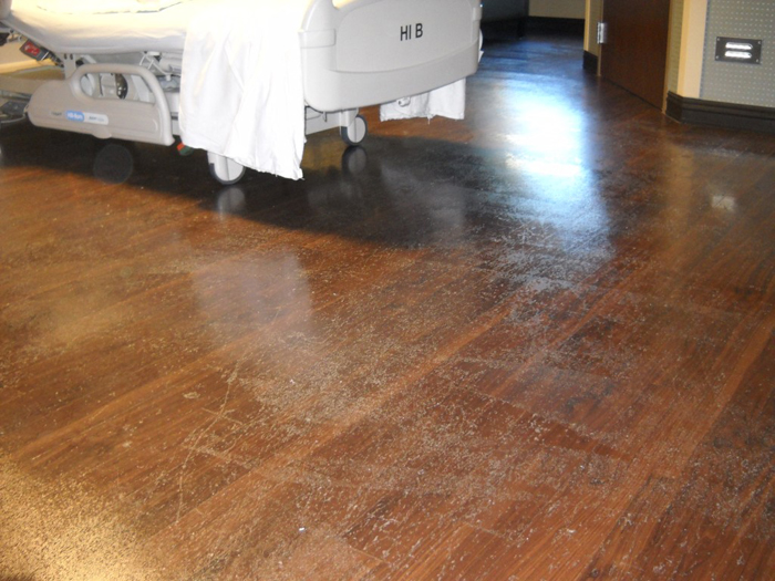 St Luke's Hospital floor scratched, scuffed from hospital rolling beds and equipment.