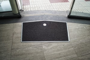 entry door mats keep wet and dirt off the floor.