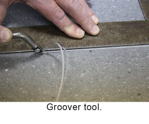groover tool in use